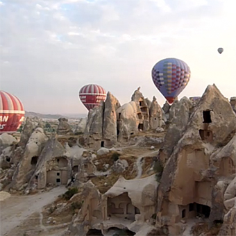 Hot air balloon over the rock formations in the Cappadocia region